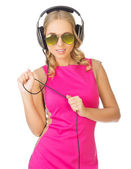 Girl with sunglasses and headphones — Photo