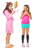 Funny housewife with books and megaphone screams to girl — Stock Photo