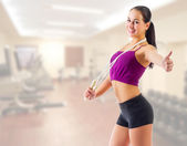 Sporty woman at gym club — Stock Photo