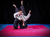 Fight between two aikido fighters — Stock Photo