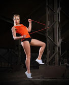 Sporty woman in orange skirt (normal version) — Stock Photo