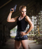 Woman in uniform with gun (normal version) — Stock Photo