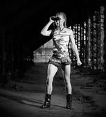 Woman in uniform with binoculars (monochrome version) — Stock Photo