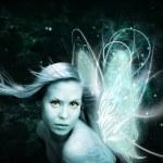 Fairy woman over dark background — Stock Photo