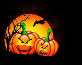Halloween pumpkins with moon over dark — Stock Photo