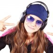 Girl with headphones listen music showing peace sign — Stock Photo