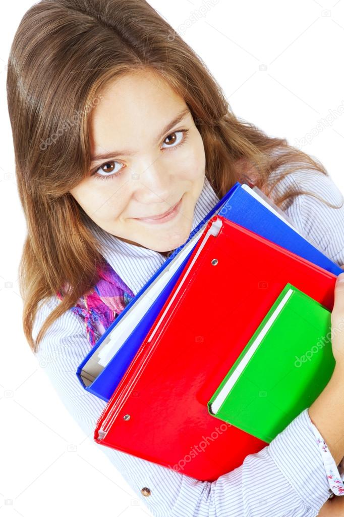 Smiling girl holding books isolated over white background  Stock Photo #12739193