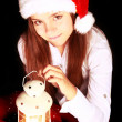 Foto de Stock  : Christmas girl with lighting lantern over dark