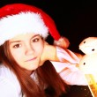 Christmas girl with lighting lantern over dark — Stock Photo #13867559