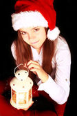 Christmas girl with lighting lantern over dark — Photo
