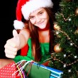Stock Photo: Christmas girl with bags pointing ok sign