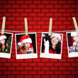Photos of christmas girls hanging on clothesline with brick wall — Stock Photo #14226101
