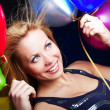 Blond woman holding ballons and celebrating — Stock Photo
