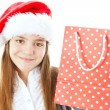 Royalty-Free Stock Photo: Smiling christmas girl holding bag isolated over white