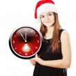 Stock Photo: Smiling christmas girl holding oclock over white