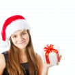 Christmas girl holding present isolated over white — Stock Photo