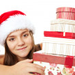 Christmas girl holding presents isolated over white — Stock Photo