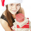Smiling christmas girl holding presents over white — Stock Photo