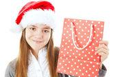 Niña sonriente de navidad con bolsa aislado en blanco — Foto de Stock