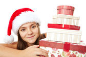 Christmas girl holding presents isolated over white — Foto de Stock