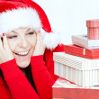 Surprised christmas woman with presents — Stock Photo #16215175