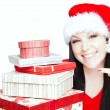 Christmas woman holding presents isolated over white - Photo