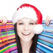 Christmas woman holding shopping bags over whit - Photo