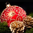 Christmas glass ball over dark - Photo