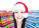 Christmas woman holding shopping bags over whit — Stockfoto