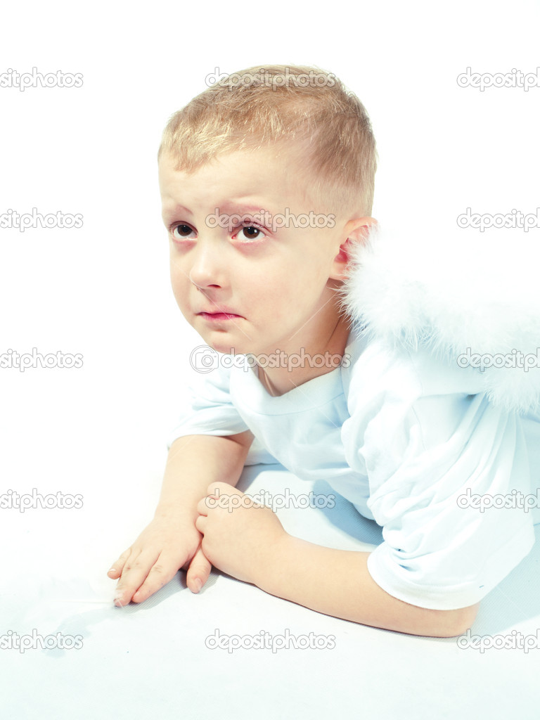 Sad angel boy with white wings holding feather — Stock Photo #16215221