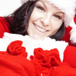 Christmas woman holding presents bags — Stock Photo #16284453