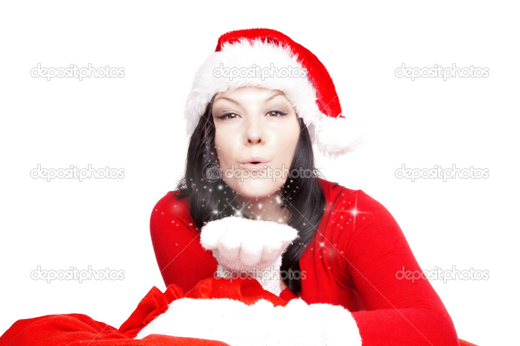 Brunette christmas woman blowing stars dust over white background — Stock Photo #16284489