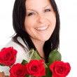 Smiling woman with bouquet of flowers — Stock Photo #1851972