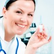 Female doctor holding medicine — Stock Photo #2095859
