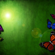 Spring green background with butterfly — Stock Photo