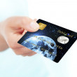 Debit card holded by hand over white — Stock Photo #23541317