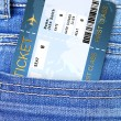 Air ticket in jeans trousers pocket — Stock Photo