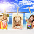Photos of holiday hanging on clothesline on beach — Stock Photo #26447781