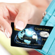Credit card in woman's hand taken out from wallet — Stock Photo