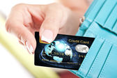 Credit card in woman's hand taken out from wallet — Photo