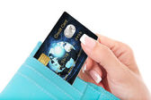 Credit card in woman's hand taken out from wallet — Stok fotoğraf