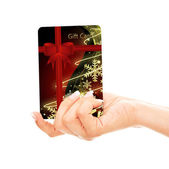 Christmas credit card holded by hand over white — Stock Photo