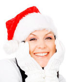 Smiling brunette woman in winter christmas clothes over white — Stock Photo