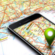 Mobile phone with gps and map in background — Foto Stock