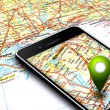 Stock Photo: Mobile phone with gps and map in background