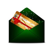 Christmas fly air ticket in green envelope isolated over white — Stock Photo