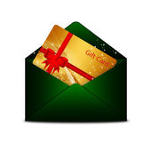Christmas gift card in green envelope isolated over white — Stock Photo