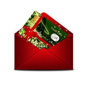 Christmas credit card in red envelope isolated over white — Photo