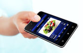 Mobile phone with takeaway restaurant order screen isolated over — Stock Photo