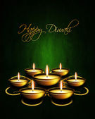 Oil lamp with diwali greetings over dark background — Stock Photo